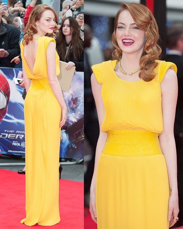 Emma Stone's dressfeatures a sexy open back with Swarovski crystal embellishments on the padded shoulders and waistband