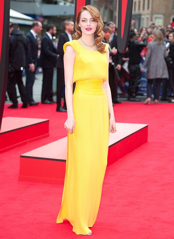 Emma Stone looked positively radiant in a vibrant yellow Atelier Versace custom gown