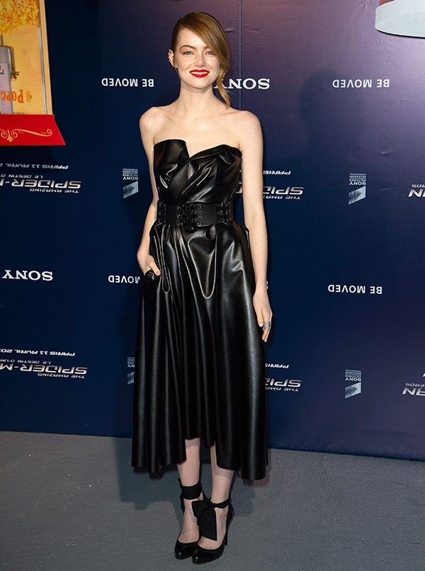 Emma Stonein a strapless Lanvin dress accented with a military-like wide belt