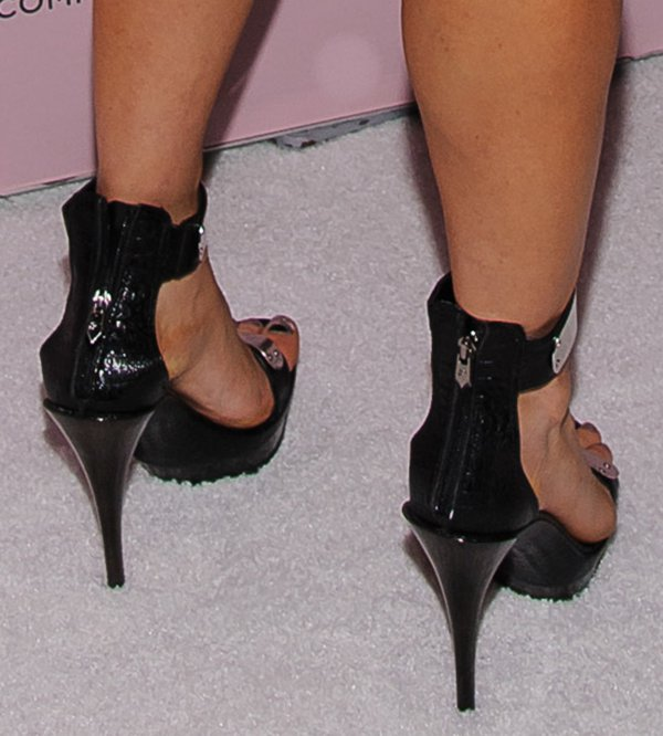 Fergie can't get enough of wearing shoes from her own collection