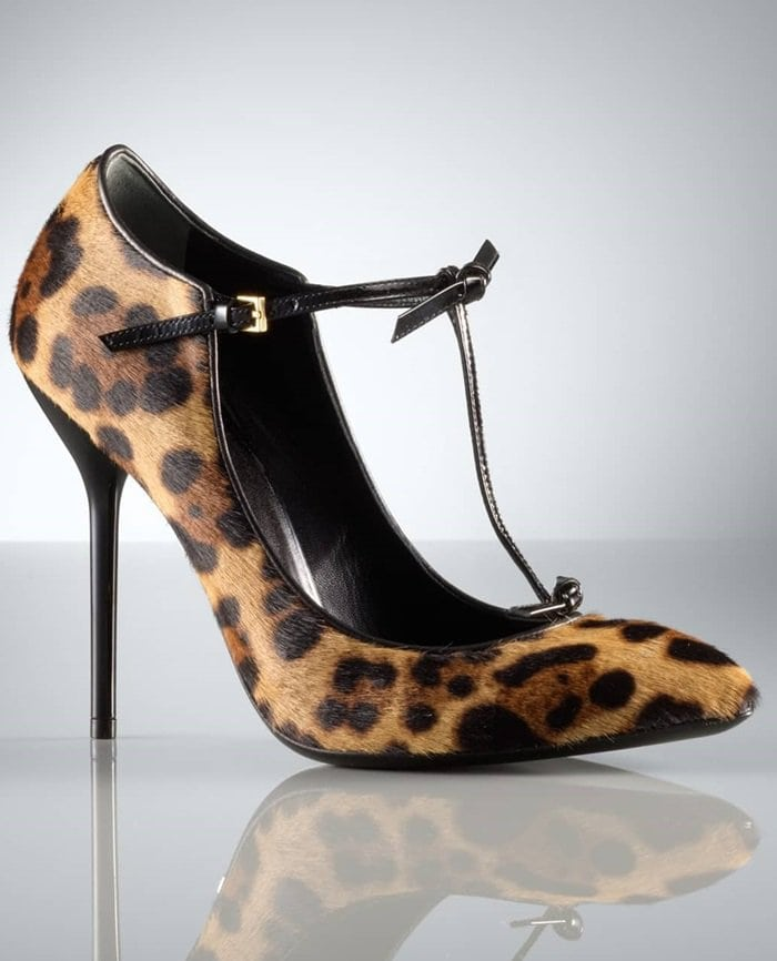 Trim twists detail the patent-leather T-strap of a leopard-patterned pump crafted from lush calf hair with a polished Gucci logo plate under the arch