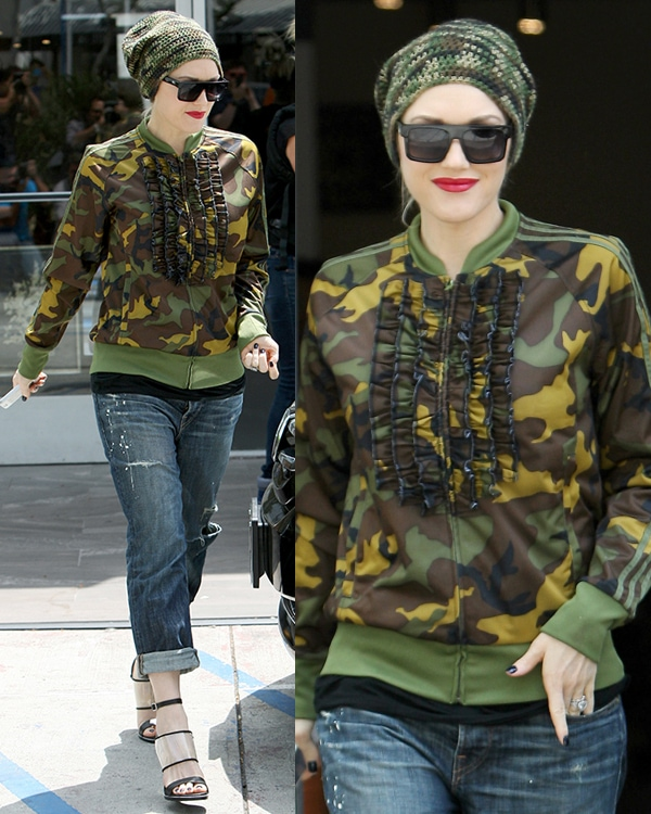 Gwen Stefani sporting an adidas Jeremy Scott ruffle camo jacket over a black top teamed with a pair of loose-fitting torn jeans