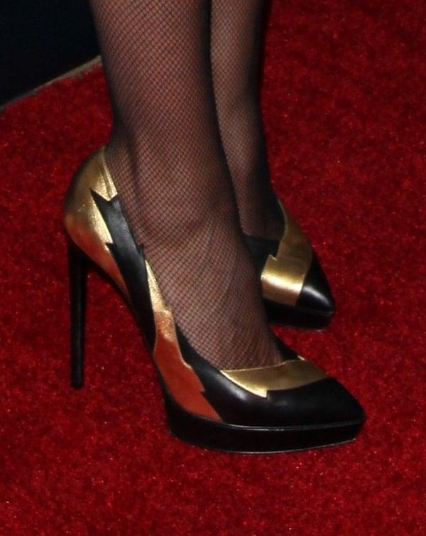 """Heidi wearing gorgeous Saint Laurent """"Janis"""" pumps that feature gold lightning details"""