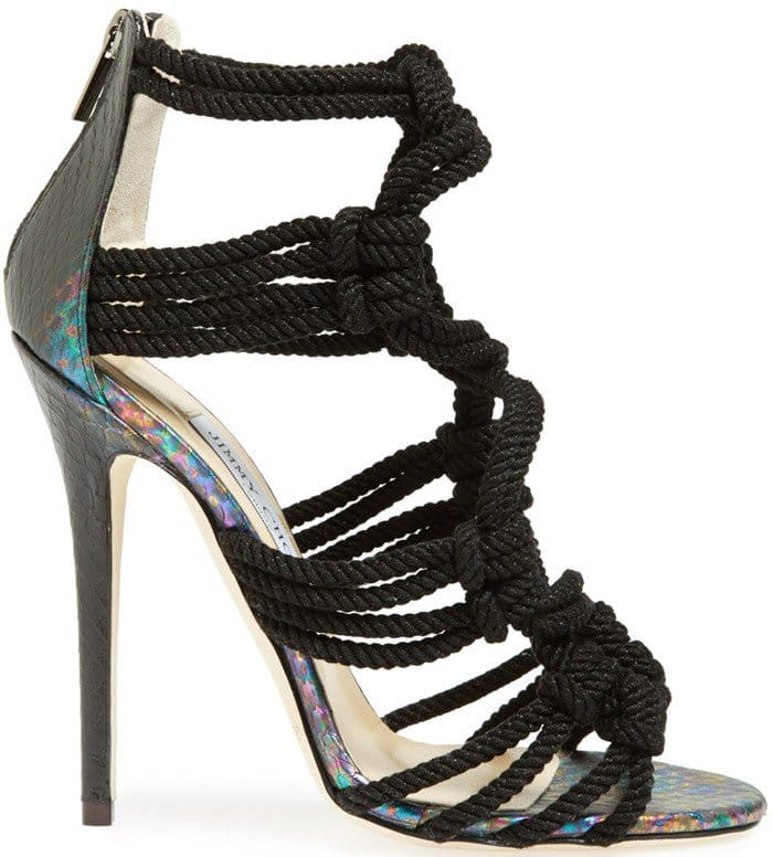 An iridescent finish illuminates the snake-stamped leather of a head-turning sandal with intricately knotted straps