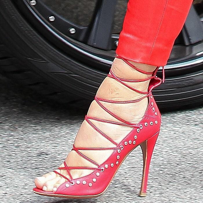 Alaia studded lace-up sandals on Kim Kardashian