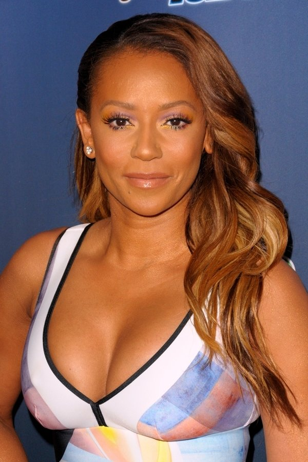 Mel B showed off her curvaceous figure in a plunging cropped top
