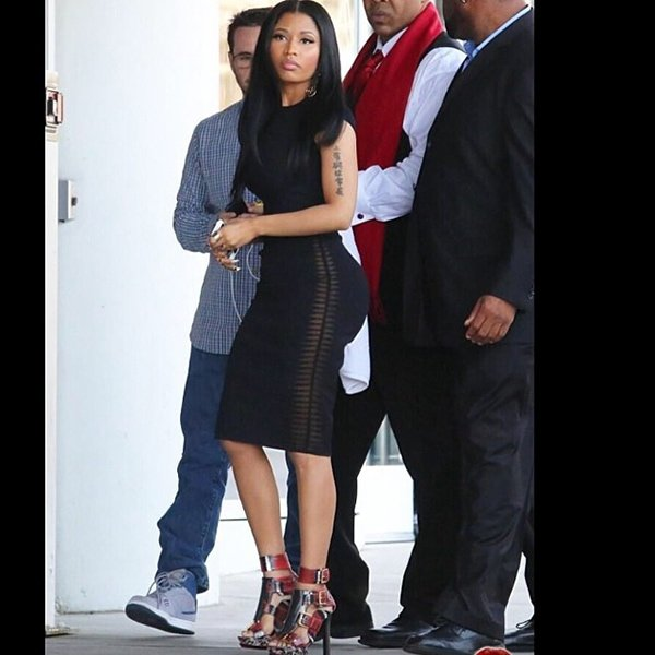 Nicki Minaj flaunted her legs in a black Alexander McQueen two-piece outfit