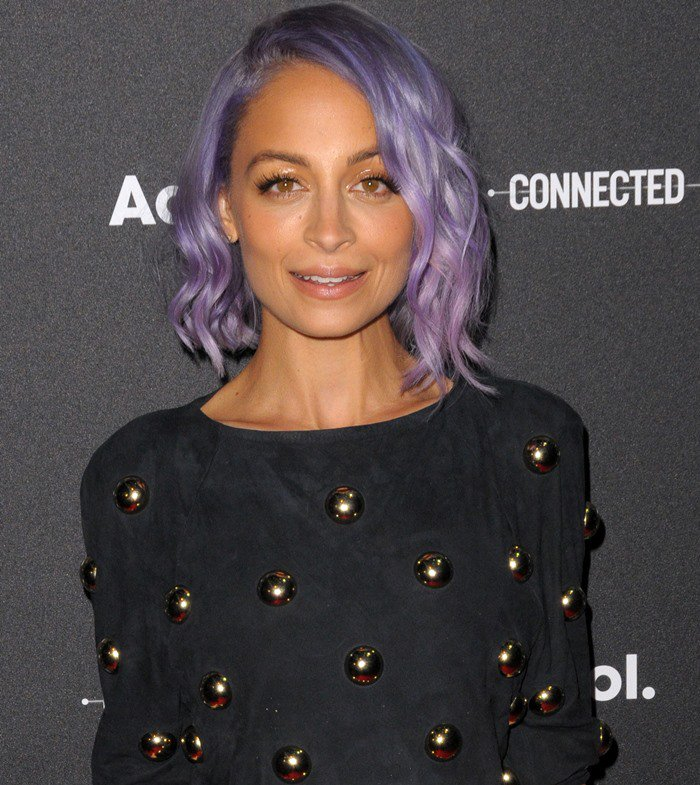 Nicole Richie slipped into a short black studded shift with side cutouts