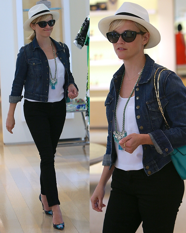 Reese Witherspoon rockingher favorite denim jacket by Current/Elliott and a black-and-white fedora