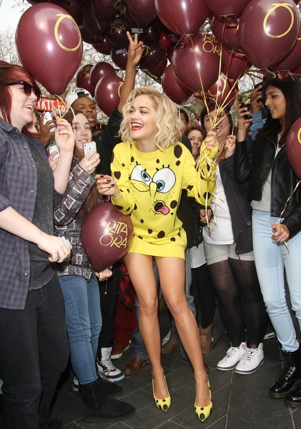 Rita Ora wearing a yellow Spongebab Squarepants jumper dress