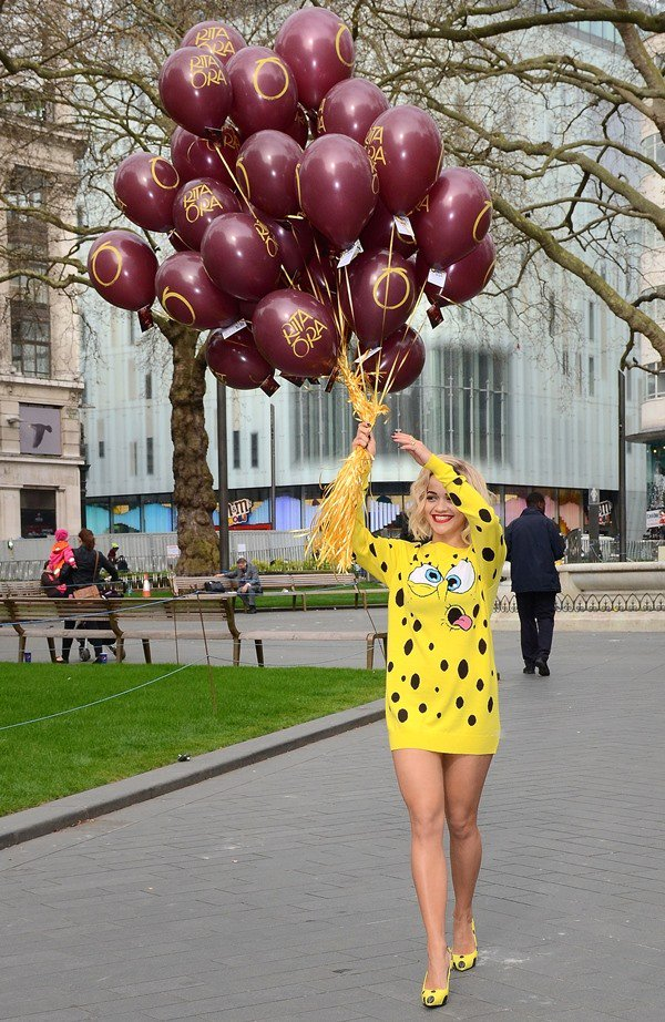 Rita Ora with a handful of balloons to celebrate with her fans