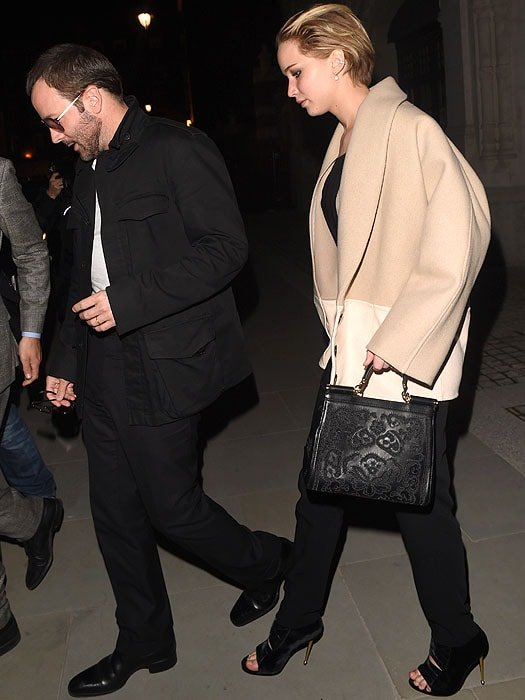 Tom Ford and Jennifer Lawrence exiting the Chiltern Firehouse in London, England, on April 25, 2014