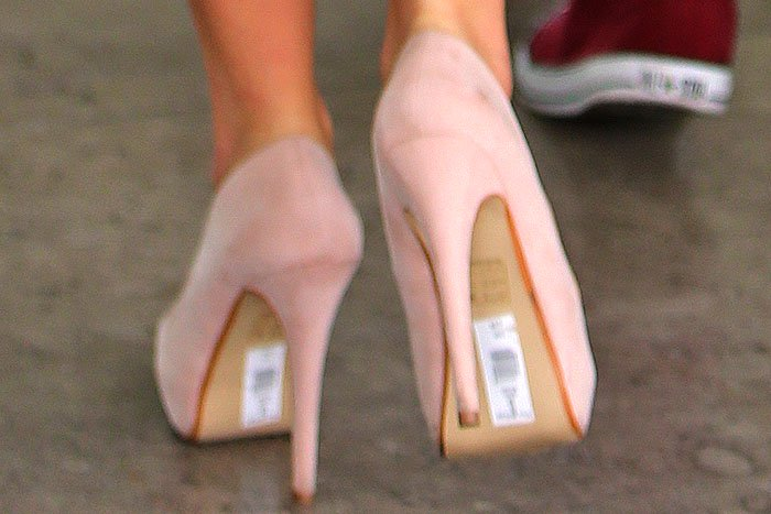 Tulisa Contostavlos with a sticker label her on shoes