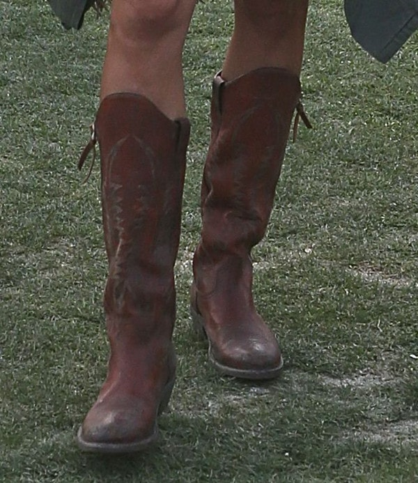 The knee-high cowboy boots Alessandra wore to match her very bohemian outfit