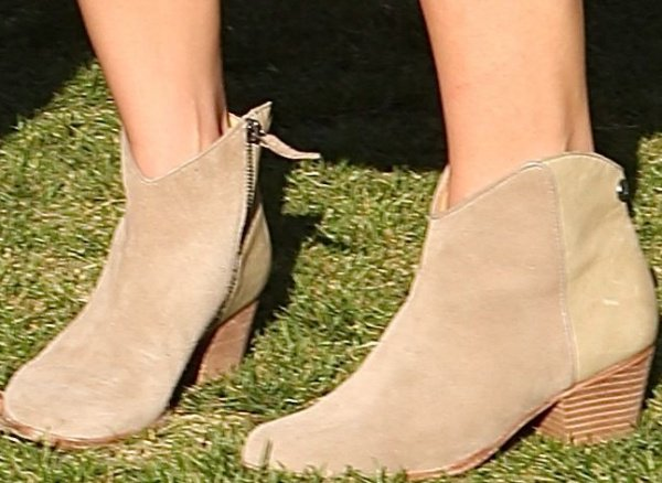 Ashley Greene wearing Western-style ankle boots