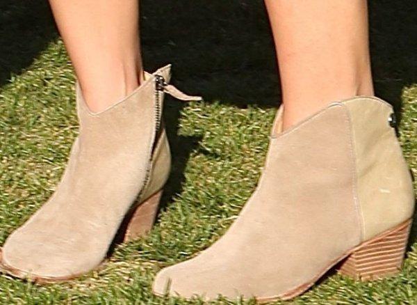 Ashley Greene wearingWestern-style ankle boots