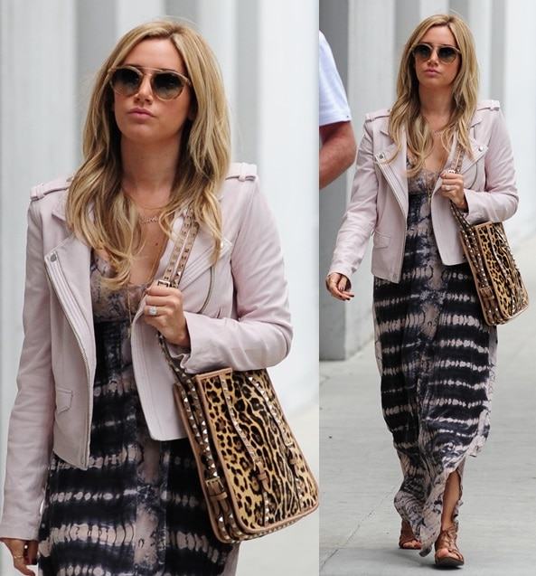 Ashley Tisdale in an interesting outfit finished with an animal-print tote and cutout lace-up sandals