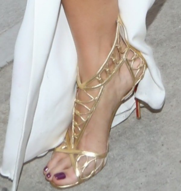 Berenice Marlohe shows off her sexy feet in Christian Louboutin sandals