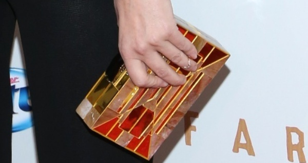 Diane Kruger carried a gold box clutch