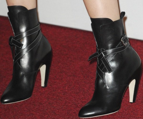 Dianna Agron wearing wraparound boots with curved heels from Louis Vuitton