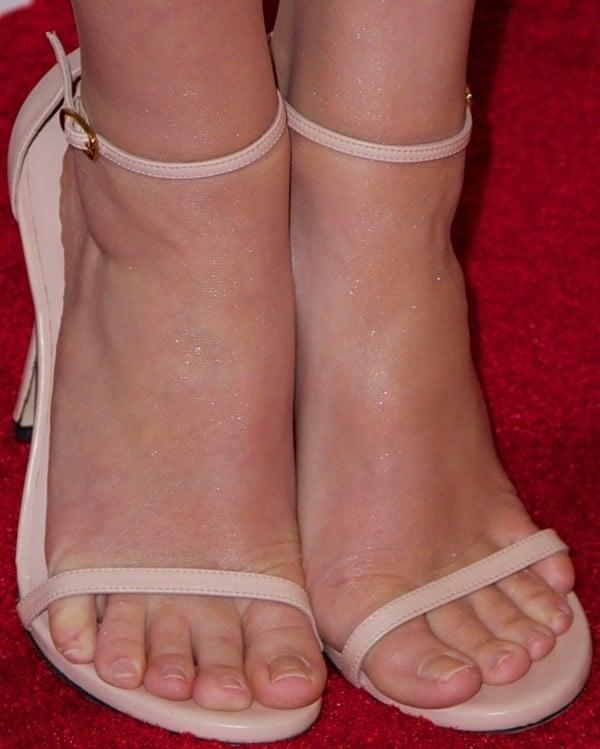 Emma Watson'snude strappy heels from Stuart Weitzman