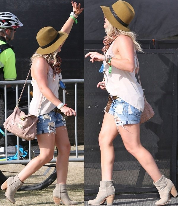Hilary Duff ina sleeveless top paired with distressed boyfriend shorts