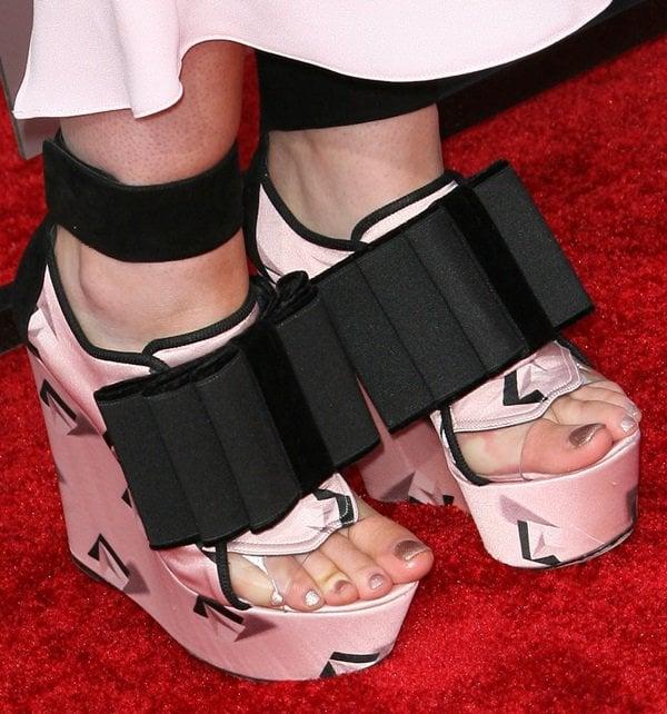 Iggy Azalea wearing John Galliano bow-detailed platform wedges