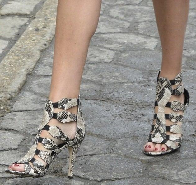 Ivanka Trump's feet in snakeskin sandals