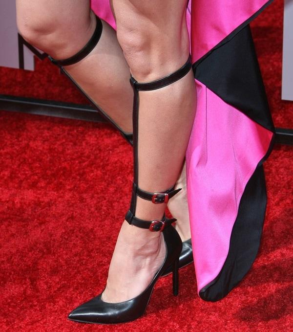 Jill Wagner flaunts her legs in black gladiator knee-high pumps