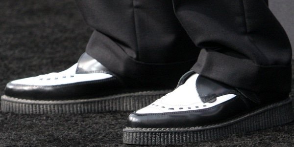 Johnny Depp wearing black-and-white brogues