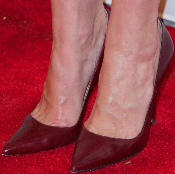 Katie Holmes shows off her feet in maroon pointy-toe pumps