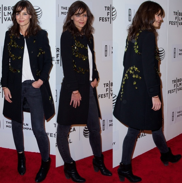 Katie Holmes wearing a beautiful black wool coat from Prada's Spring 2014 collection