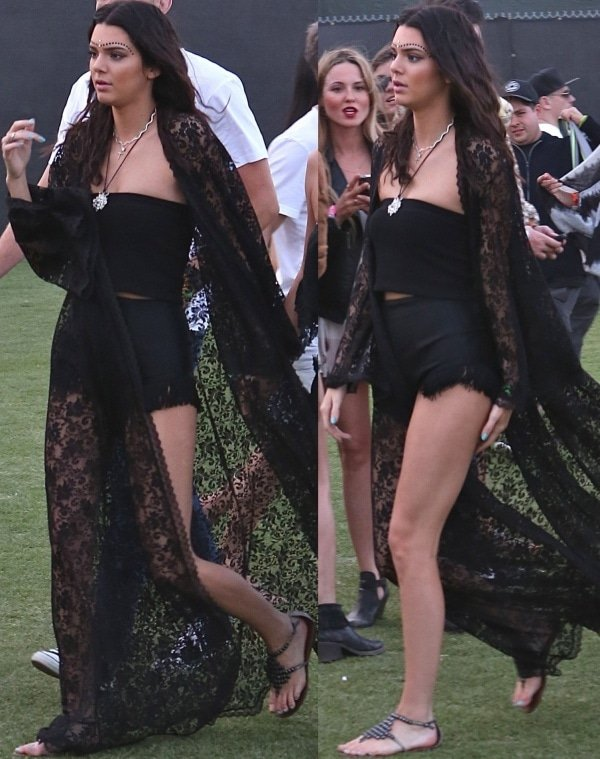 Kendall Jenner ina dramatic lace gown over a bandeau and frill-lined shorts