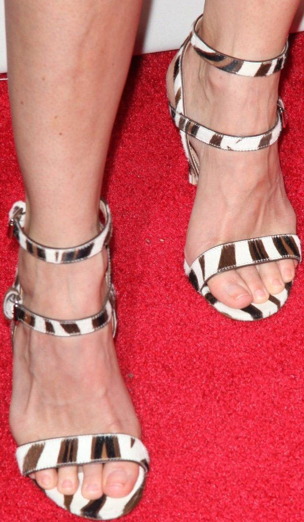 Keri wore a pair of ankle-strap heels in brown, black, and white zebra print from Gianvito Rossi