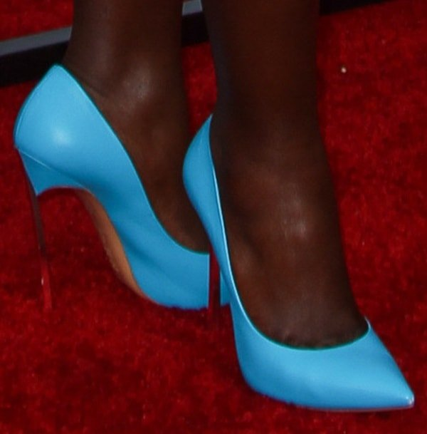 Lupita Nyong'o capping off her colorful dress with a pair of bright blue Casadei pumps at the 2014 MTV Movie Awards in Los Angeles on April 13, 2014