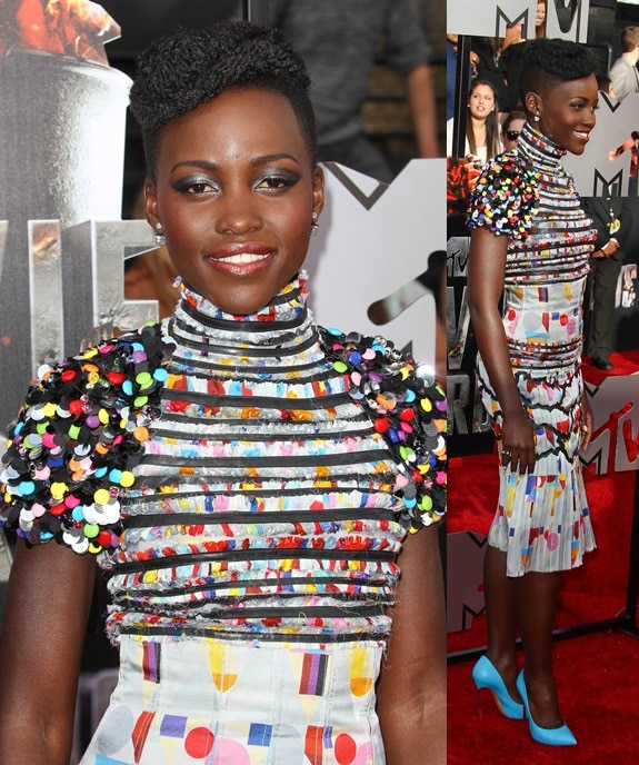Lupita Nyong'o capping off her colorful dress with bright blue Casadei pumps