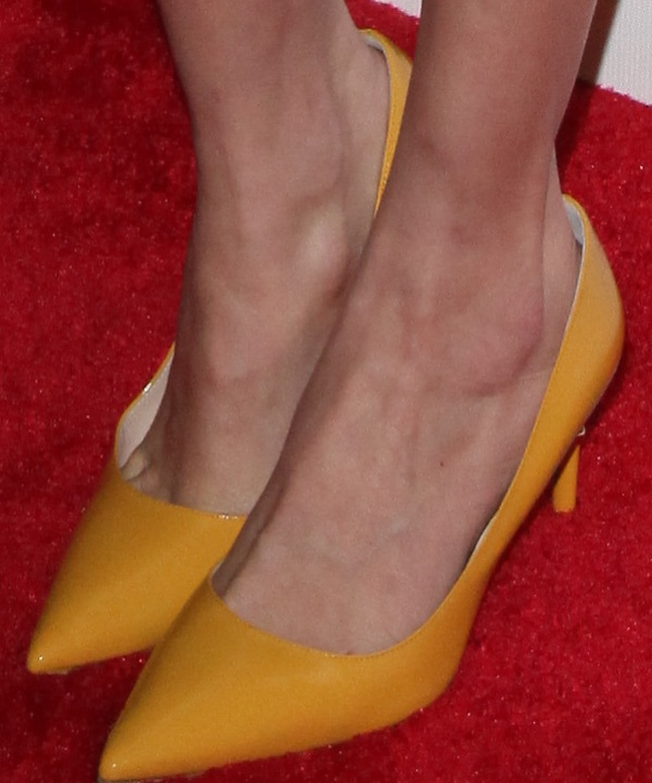 Maggie Grace shows off her feet incanary yellow pumps