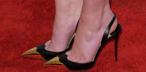 Mary Elizabeth Winstead in black-and-gold slingback pumps from Christian Louboutin