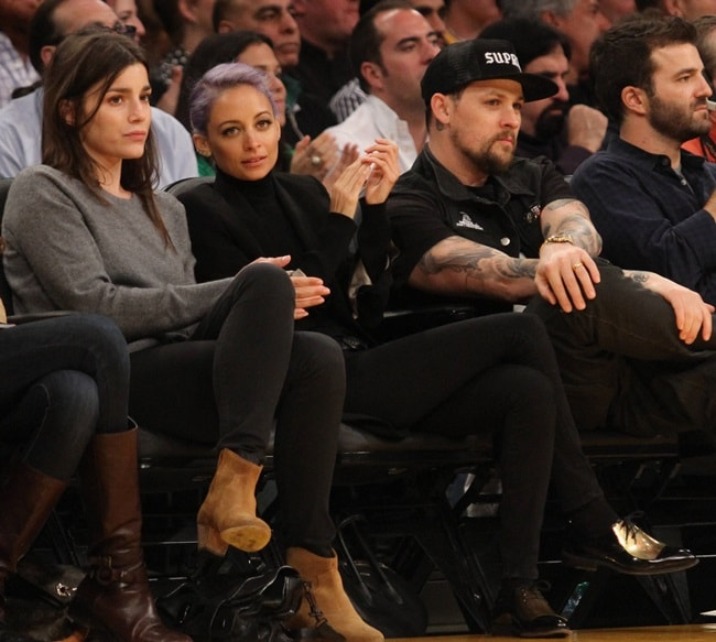 Nicole Richie wearing Celine metal plate oxfords to the Lakers vs. Blazers game in Los Angeles on April 1, 2014