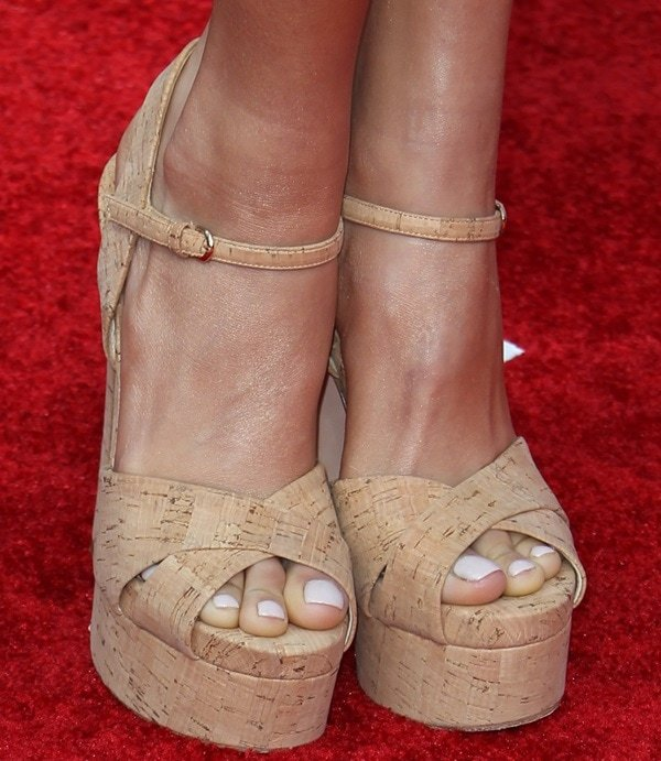 Pia Mia wearing a pair of all-cork sandals with her head-to-toe purple outfit to the 2014 MTV Movie Awards in Los Angeles on April 13, 2014