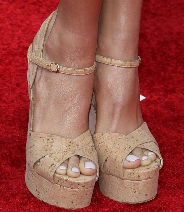 Pia Mia's pretty feet in all-cork platform sandals