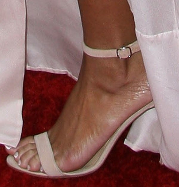 Rihanna displays her hot feet in Chaos shoes