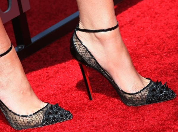 Zendaya Coleman punctuated the look with barely there makeup and a pair of uber exquisite spiked cap-toe ankle-strap pumps in black lace