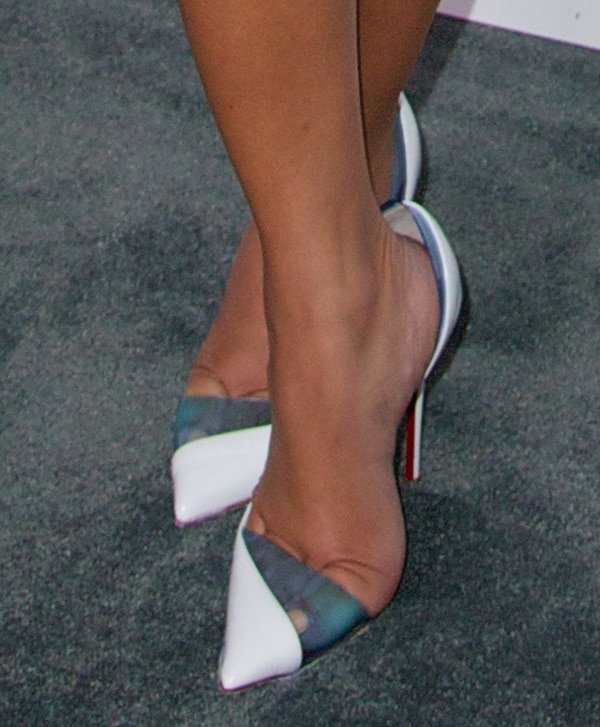 Adrienne Bailon shows off her feet in Christian Louboutin pumps