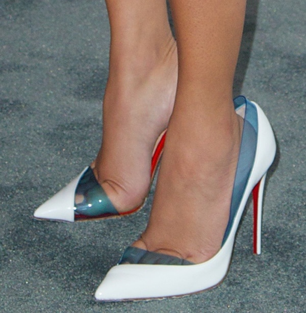 Adrienne Bailon shows off her feet in white Christian Louboutin high heels