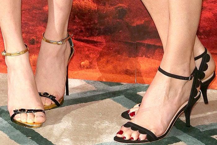 Giuseppe Zanotti skinny-strap sandals on Amanda Seyfried and Loeffler Randall 'Lillit' sandals on Charlize Theron