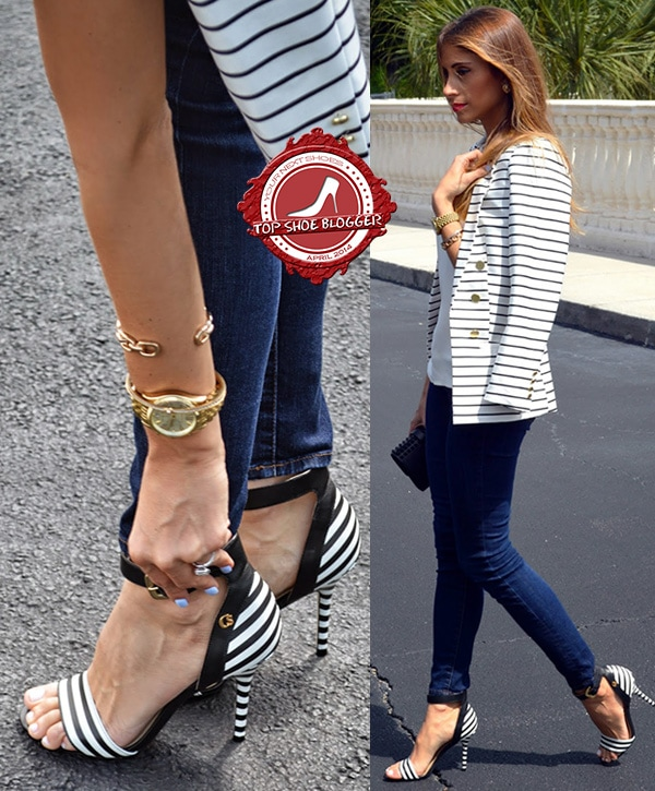 Ananda wears a striped jacket with matching heels and blue jeans
