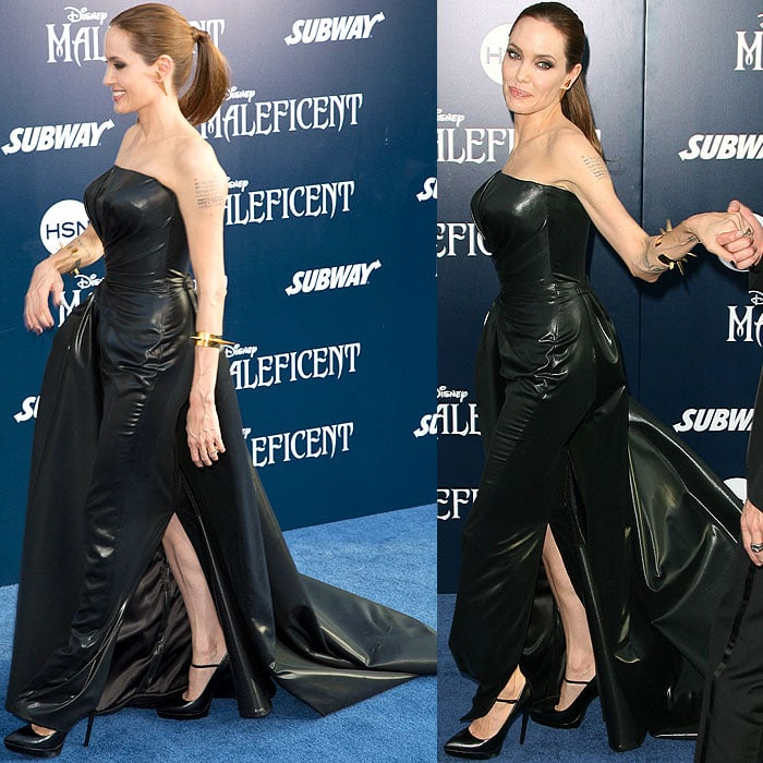 Angelina Jolie in a Versace black-leather strapless gown and Saint Laurent Janis mary-jane pumps
