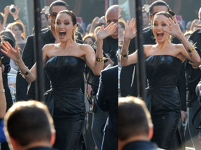 Angelina Jolie looking shocked and thrilled to see a group of little girls dressed as Maleficent