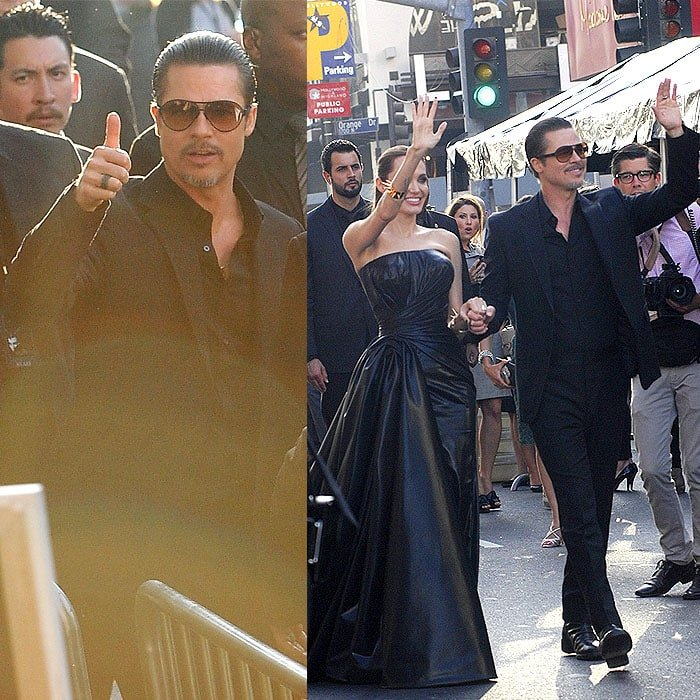 Brad Pitt signaling that he's okay and continuing waving to the crowd after the attempted assault